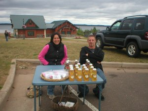 Joy and Nate at Happy Tonics table at Shell Lake's Farmers Market 2009