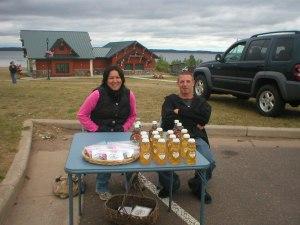 Joy and Nate at Happy Tonics table at Shell Lake's Farmers Market 2009