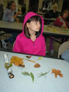 Alex paying attention to learning to identify leaves