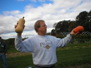 Kevin showing a button bottom and a peanut shaped squash
