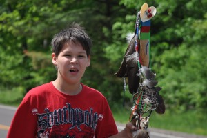 Conner Beauleu carries Eagle feather staff.