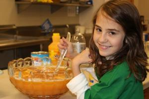 Emily Lloyd making punch for the Girl Scout Silver Awards Ceremony