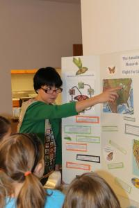 Dakota Robinson teaches brownies about monarch butterfly migration.