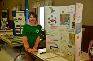 Dakota Robinson displays Monarch Migration storyboard at IV Annual Earth Day Event