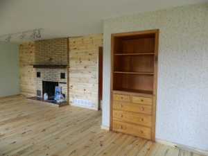 Built in cabinets and new knotty pine accent wall and red pine plank floors.