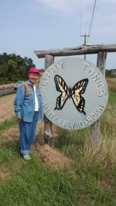 Valerie Downes Lusko next to Mr. Wolf's sign, which has been removed. It is going to our new habitat at LCO Agricultural and Research Station.